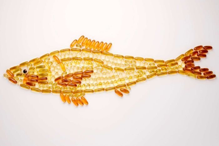 Fast&Up Promega capsules arranged in the shape of a fish