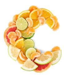 Orange and lemon slices arranged in C shape