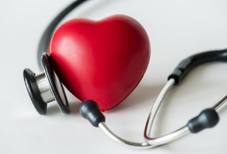 Stethoscope and a pink plastic heart