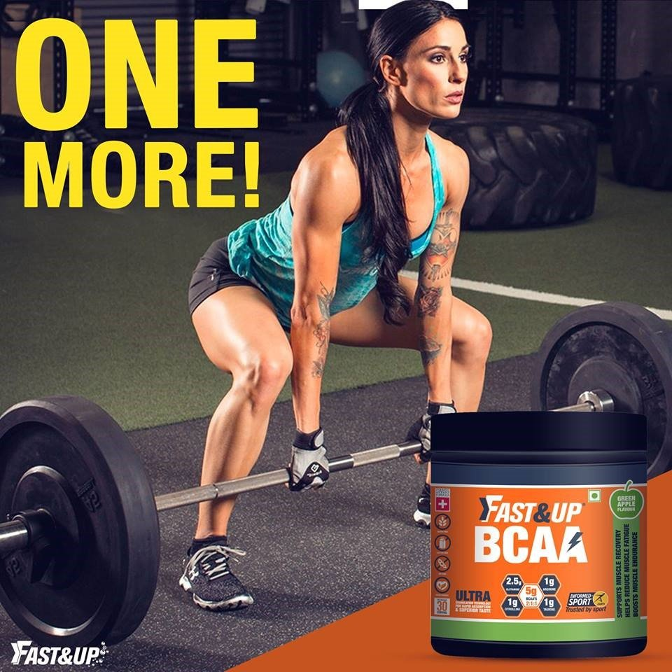Female athlete doing dead lift with Fast&Up BCAA kept in the corner