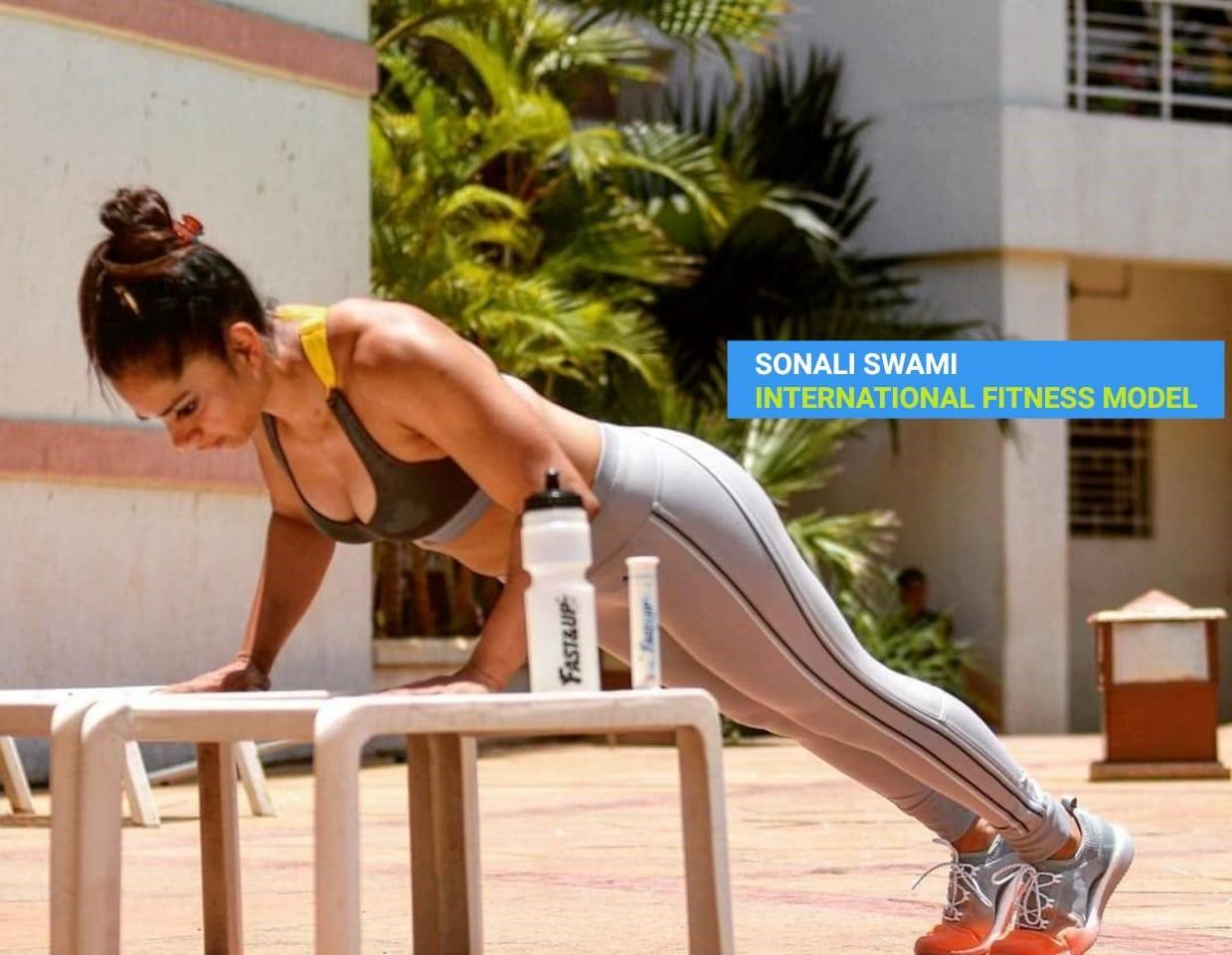 Sonali Swami, an international fitness model doing inclined push ups